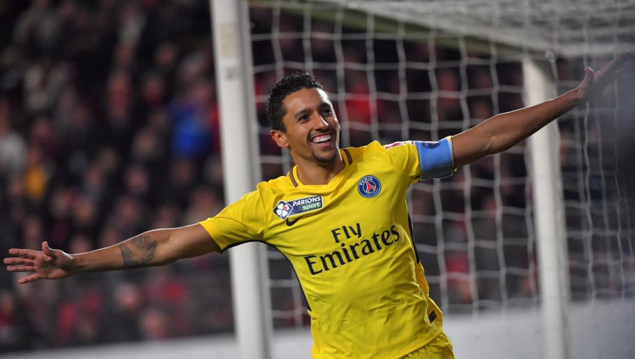 Paris Saint-Germain's Brazilian defender Marquinhos celebrates after scoring a goal during the French League Cup football semi-final match between Rennes and Paris Saint-Germain at the Roazhon Park stadium in Rennes on January 30, 2018. / AFP PHOTO / LOIC VENANCE        (Photo credit should read LOIC VENANCE/AFP/Getty Images)