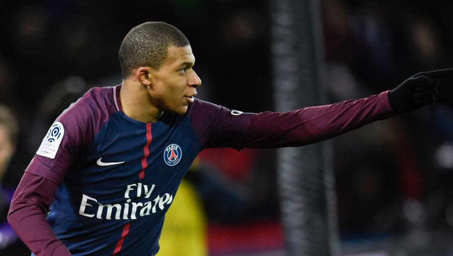 Paris Saint-Germain's French forward Kylian Mbappe celebrates after scoring a goal during the French L1 football match between Paris Saint-Germain and Dijon on January 17, 2018 at the Parc des Princes stadium in Paris. / AFP PHOTO / CHRISTOPHE SIMON        (Photo credit should read CHRISTOPHE SIMON/AFP/Getty Images)