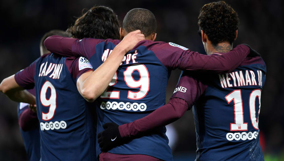 (From L) Paris Saint-Germain's Uruguayan forward Edinson Cavani, Paris Saint-Germain's French forward Kylian Mbappe and Paris Saint-Germain's Brazilian forward Neymar celebrate after scoring during the French L1 football match between Paris Saint-Germain and Dijon on January 17, 2018 at the Parc des Princes stadium in Paris. / AFP PHOTO / CHRISTOPHE SIMON        (Photo credit should read CHRISTOPHE SIMON/AFP/Getty Images)