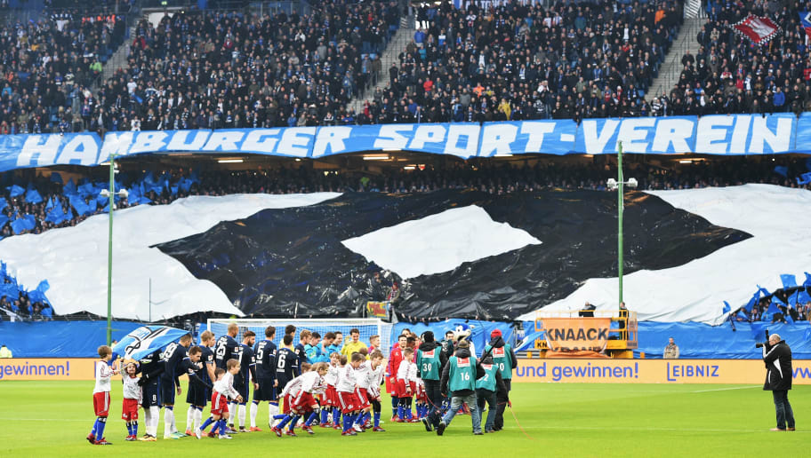 HAMBURG, GERMANY - MARCH 06:  Fans of Hamburg make a banner in the form of the club logo during the Bundesliga match between Hamburger SV and Hertha BSC at Volksparkstadion on March 6, 2016 in Hamburg, Germany.  (Photo by Stuart Franklin/Bongarts/Getty Images)