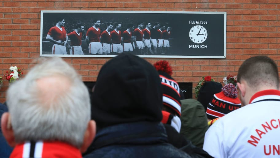 Manchester United fans attend a ceremony to remember the victims of the 1958 Munich air disaster during the English Premier League football match between Manchester United and Watford at Old Trafford in Manchester, north west England, on February 11, 2017. The Munich air disaster happened on February 6, 1958 when the plane carrying Manchester United team players, staff, supporters and journalists crashed in poor weather on take off from Munich resulting in a total of 23 casualties, including 11 Manchester United team members and staff. / AFP / Lindsey PARNABY / RESTRICTED TO EDITORIAL USE. No use with unauthorized audio, video, data, fixture lists, club/league logos or 'live' services. Online in-match use limited to 75 images, no video emulation. No use in betting, games or single club/league/player publications.  /         (Photo credit should read LINDSEY PARNABY/AFP/Getty Images)