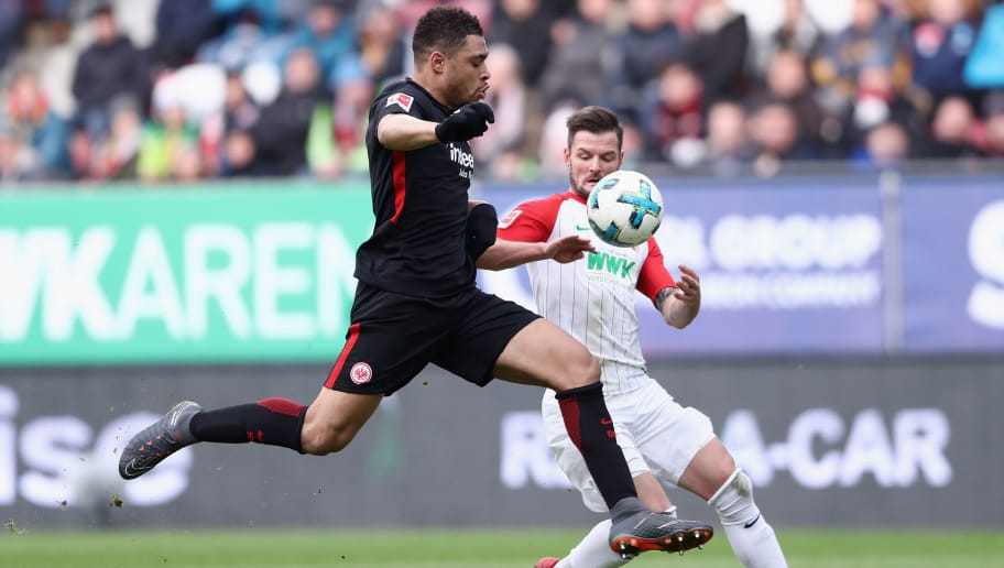 AUGSBURG, GERMANY - FEBRUARY 04: Marcel Heller (back) of Augsburg is challenged by Simon Falette of Frankfurt during the Bundesliga match between FC Augsburg and Eintracht Frankfurt at WWK-Arena on February 4, 2018 in Augsburg, Germany.  (Photo by Alex Grimm/Bongarts/Getty Images)