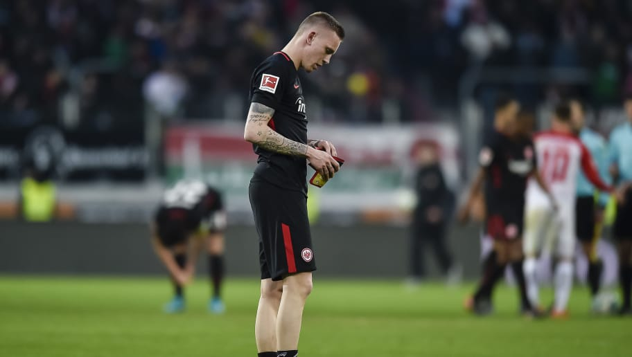 Frankfurt's German forward Marius Wolf reacts at the end of the German first division Bundesliga football match 1 FC Augsburg vs Eintracht Frankfurt in Augsburg, southern Germany, on February 4, 2018. / AFP PHOTO / Guenter SCHIFFMANN / RESTRICTIONS: DURING MATCH TIME: DFL RULES TO LIMIT THE ONLINE USAGE TO 15 PICTURES PER MATCH AND FORBID IMAGE SEQUENCES TO SIMULATE VIDEO. == RESTRICTED TO EDITORIAL USE == FOR FURTHER QUERIES PLEASE CONTACT DFL DIRECTLY AT + 49 69 650050         (Photo credit should read GUENTER SCHIFFMANN/AFP/Getty Images)