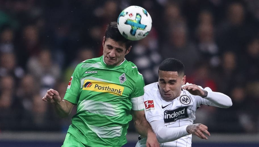FRANKFURT AM MAIN, GERMANY - JANUARY 26: Omar Mascarell (R) of Eintracht Frankfurt and Lars Stindl of Moenchengladbach battle for the ball during the Bundesliga match between Eintracht Frankfurt and Borussia Moenchengladbach at Commerzbank-Arena on January 26, 2018 in Frankfurt am Main, Germany. (Photo by Alex Grimm/Bongarts/Getty Images)