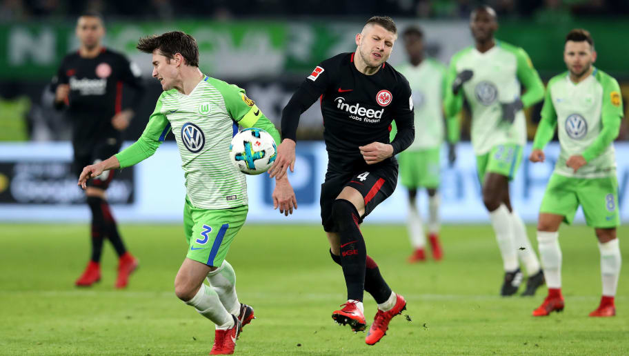 WOLFSBURG, GERMANY - JANUARY 20: Ante Rebic (R) of Frankfurt and Paul Verhaegh (L) of Wolfsburg compete during the Bundesliga match between VfL Wolfsburg and Eintracht Frankfurt at Volkswagen Arena on January 20, 2018 in Wolfsburg, Germany. (Photo by Ronny Hartmann/Bongarts/Getty Images)