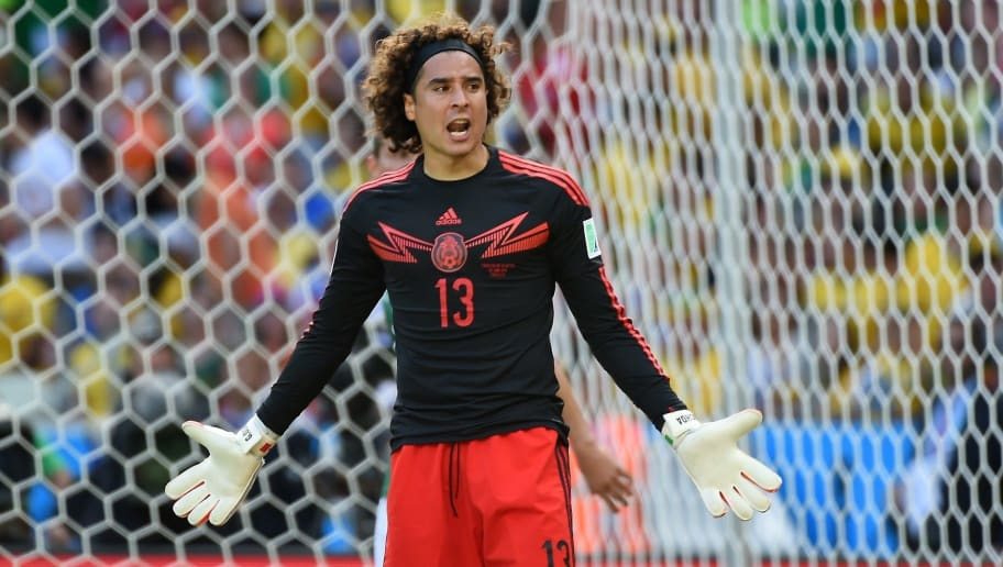 Mexico's goalkeeper Guillermo Ochoa reacts after a failed attempt on goal by Netherlands' forward Arjen Robben during a Round of 16 football match between Netherlands and Mexico at Castelao Stadium in Fortaleza during the 2014 FIFA World Cup on June 29, 2014. AFP PHOTO / EMMANUEL DUNAND        (Photo credit should read EMMANUEL DUNAND/AFP/Getty Images)