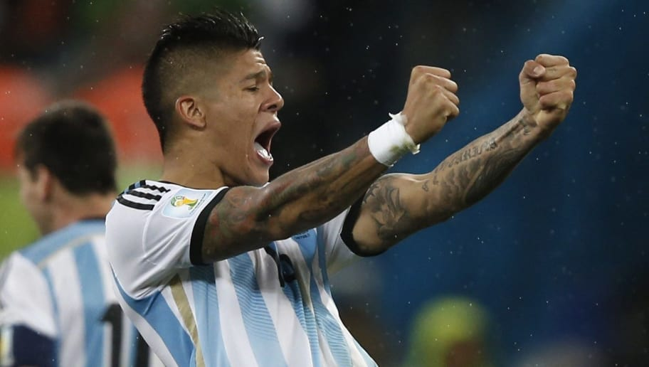 Argentina's defender Marcos Rojo  celebrates during a penalty shoot-out of the semi-final football match between Netherlands and Argentina of the FIFA World Cup at The Corinthians Arena in Sao Paulo on July 9, 2014.   AFP PHOTO / ADRIAN DENNIS        (Photo credit should read ADRIAN DENNIS/AFP/Getty Images)