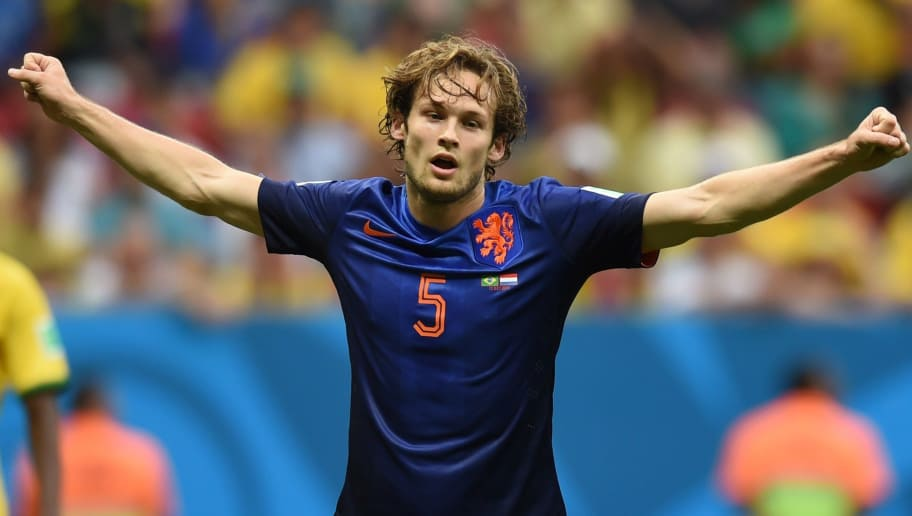 Netherlands' defender Daley Blind celebrates after scoring his team's second goal during the third place play-off football match between Brazil and Netherlands during the 2014 FIFA World Cup at the National Stadium in Brasilia on July 12, 2014.  AFP PHOTO / VANDERLEI ALMEIDA        (Photo credit should read VANDERLEI ALMEIDA/AFP/Getty Images)