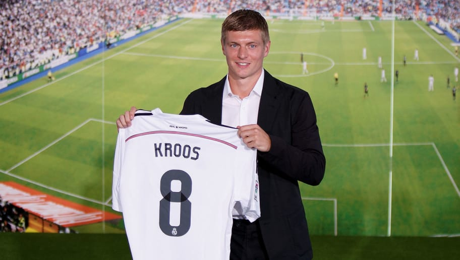 MADRID, SPAIN - JULY 17:  . Toni Kroos poses for photographers with his new Real Madrid shirt during his official unveiling at Santiago Bernabeu Stadium on July 17, 2014 in Madrid, Spain. Toni Kroos who won the World Cup with Germany in Brazil is Real Madrid's first signing in the new season.  (Photo by Pablo Blazquez Dominguez/Getty Images)
