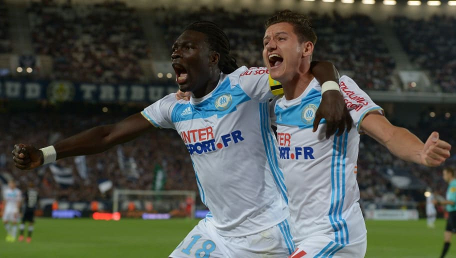 Marseille's French forward Bafetimbi Gomis (L) celebrates after scoring a goal with teammate Florian Thauvin during the French L1 football match between Bordeaux and Marseille on May 14, 2017 at the Matmut Atlantique stadium in Bordeaux, southwestern France.  / AFP PHOTO / NICOLAS TUCAT        (Photo credit should read NICOLAS TUCAT/AFP/Getty Images)