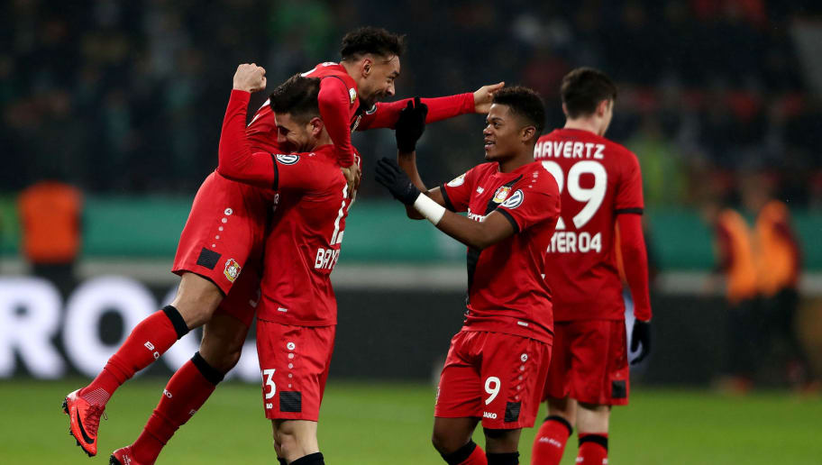 LEVERKUSEN, GERMANY - FEBRUARY 06: Karim Bellarabi (L) of Leverkusen celebrate with his team mates after he scores the 3rd goal during extzra time during the DFB Cup quarter final match between Bayer Leverkusen and Werder Bremen at BayArena on February 6, 2018 in Leverkusen, Germany.  (Photo by Alex Grimm/Bongarts/Getty Images)