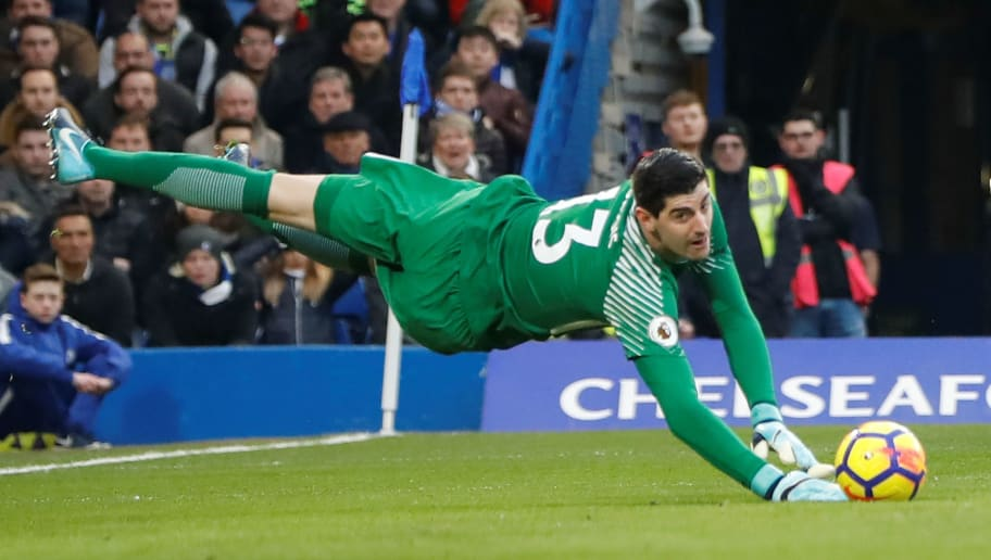 Chelsea's Belgian goalkeeper Thibaut Courtois makes a save during the English Premier League football match between Chelsea and Leicester City at Stamford Bridge in London on January 13, 2018. / AFP PHOTO / Tolga AKMEN / RESTRICTED TO EDITORIAL USE. No use with unauthorized audio, video, data, fixture lists, club/league logos or 'live' services. Online in-match use limited to 75 images, no video emulation. No use in betting, games or single club/league/player publications.  /         (Photo credit should read TOLGA AKMEN/AFP/Getty Images)