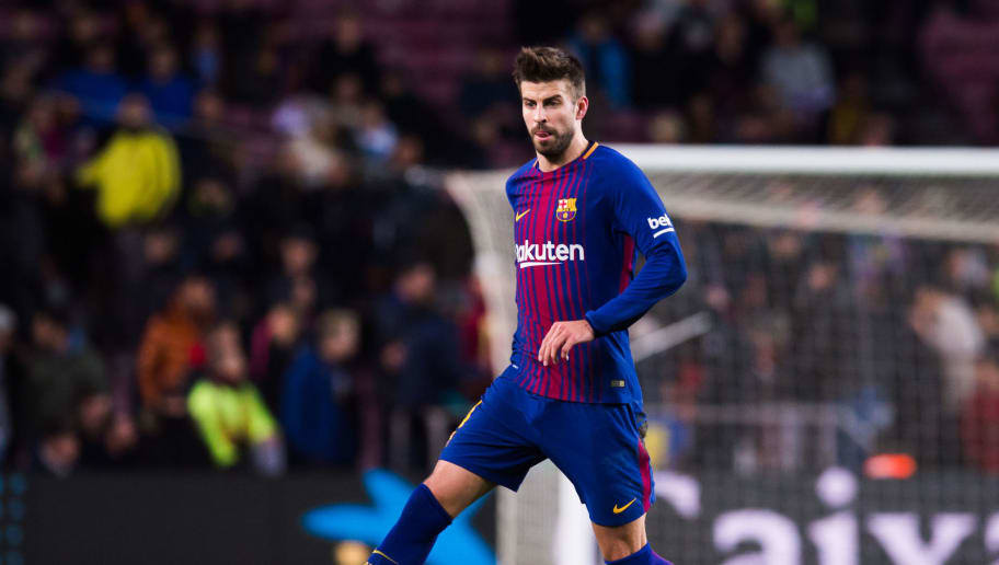 BARCELONA, SPAIN - FEBRUARY 01:  Gerard Pique of FC Barcelona conducts the ball during the Copa del Rey semi-final first leg match between FC Barcelona and Valencia CF at Camp Nou on February 1, 2018 in Barcelona, Spain.  (Photo by Alex Caparros/Getty Images)