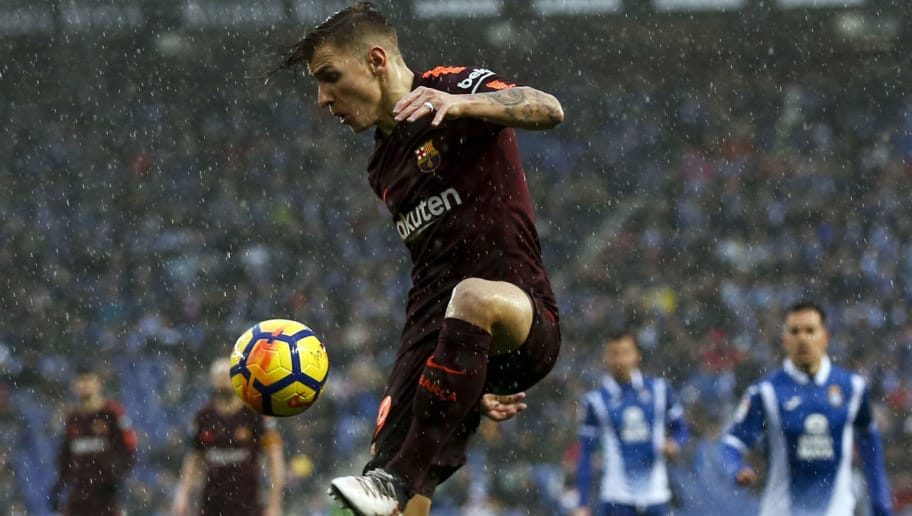 Barcelona's French defender Lucas Digne controls the ball during the Spanish league football match between RCD Espanyol and FC Barcelona at the RCDE Stadium in Cornella de Llobregat on February 4, 2018. / AFP PHOTO / PAU BARRENA        (Photo credit should read PAU BARRENA/AFP/Getty Images)