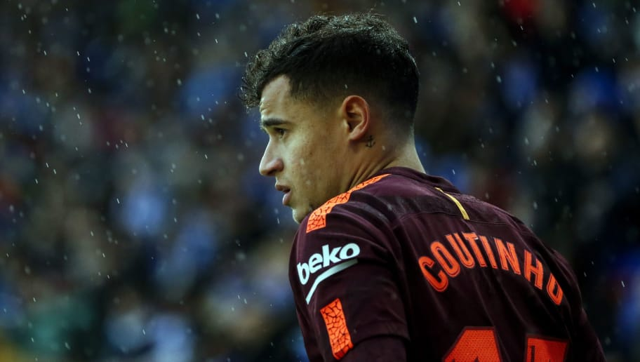 Barcelona's Brazilian midfielder Philippe Coutinho looks on during the Spanish league football match between RCD Espanyol and FC Barcelona at the RCDE Stadium in Cornella de Llobregat on February 4, 2018. / AFP PHOTO / PAU BARRENA        (Photo credit should read PAU BARRENA/AFP/Getty Images)