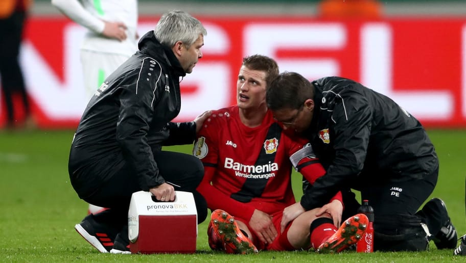 LEVERKUSEN, GERMANY - FEBRUARY 06: Lars Bender of Leverkusen gets medical treatment during the DFB Cup quarter final match between Bayer Leverkusen and Werder Bremen at BayArena on February 6, 2018 in Leverkusen, Germany.  (Photo by Alex Grimm/Bongarts/Getty Images)