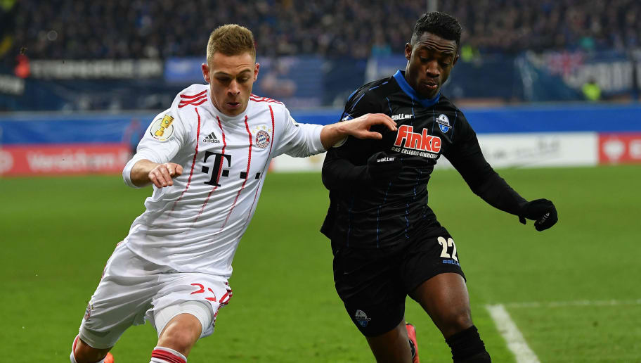 PADERBORN, GERMANY - FEBRUARY 06:  Joshua KimmichÊof Muenchen is challenged by Christopher Antwi-Adjej of Bielefeld during the DFB Pokal quater final match between SC Paderborn and Bayern Muenchen at Benteler Arena on February 6, 2018 in Paderborn, Germany.  (Photo by Stuart Franklin/Bongarts/Getty Images)