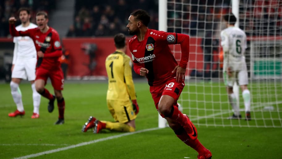 LEVERKUSEN, GERMANY - FEBRUARY 06:  Karim Bellarabi #38 of Leverkusen celebrates after he scores the 3rd goal during extra time during the DFB Cup quarter final match between Bayer Leverkusen and Werder Bremen at BayArena on February 6, 2018 in Leverkusen, Germany.  (Photo by Alex Grimm/Bongarts/Getty Images)