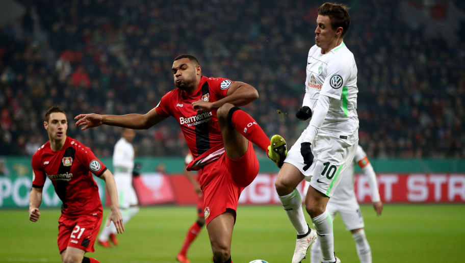 LEVERKUSEN, GERMANY - FEBRUARY 06: Jonathan Tah (L) of Leverkusen tackles Max Kruse of Bremen during the DFB Cup quarter final match between Bayer Leverkusen and Werder Bremen at BayArena on February 6, 2018 in Leverkusen, Germany.  (Photo by Alex Grimm/Bongarts/Getty Images)