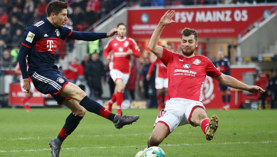 MAINZ, GERMANY - FEBRUARY 03: Robert Lewandowski of Muenchen is challenged by kz42 of Mainz during the Bundesliga match between 1. FSV Mainz 05 and FC Bayern Muenchen at Opel Arena on February 3, 2018 in Mainz, Germany.  (Photo by Alex Grimm/Bongarts/Getty Images)