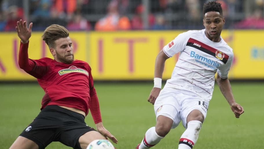 Freiburg's forward Lucas Hoeler (L) and Leverkusen's Brazilian defender Wendell vie for the ball during the German first division Bundesliga football match SC Freiburg versus Bayer Leverkusen on February 3, 2018 in Freiburg. / AFP PHOTO / THOMAS KIENZLE / RESTRICTIONS: DURING MATCH TIME: DFL RULES TO LIMIT THE ONLINE USAGE TO 15 PICTURES PER MATCH AND FORBID IMAGE SEQUENCES TO SIMULATE VIDEO. == RESTRICTED TO EDITORIAL USE == FOR FURTHER QUERIES PLEASE CONTACT DFL DIRECTLY AT + 49 69 650050         (Photo credit should read THOMAS KIENZLE/AFP/Getty Images)