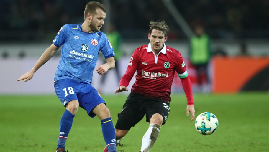 HANOVER, GERMANY - JANUARY 13:  Oliver Sorg (R) of Hannover and Daniel Brosinski (L) of Mainz  compete for the ball during the Bundesliga match between Hannover 96 and 1. FSV Mainz 05 at HDI-Arena on January 13, 2018 in Hanover, Germany.  (Photo by Oliver Hardt/Bongarts/Getty Images)
