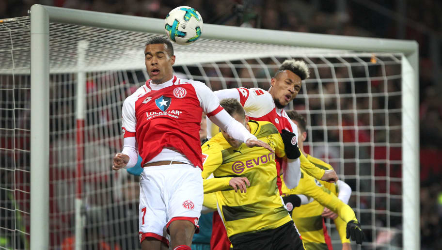 Mainz' Swedish midfielder Robin Quaison (L) vies with Dortmund's Ukrainian forward Andriy Yarmolenko (C) during the German first division Bundesliga football match between Mainz 05 and Borussia Dortmund on December 12, 2017 in Mainz.  / AFP PHOTO / Daniel ROLAND / RESTRICTIONS: DURING MATCH TIME: DFL RULES TO LIMIT THE ONLINE USAGE TO 15 PICTURES PER MATCH AND FORBID IMAGE SEQUENCES TO SIMULATE VIDEO. == RESTRICTED TO EDITORIAL USE == FOR FURTHER QUERIES PLEASE CONTACT DFL DIRECTLY AT + 49 69 650050         (Photo credit should read DANIEL ROLAND/AFP/Getty Images)