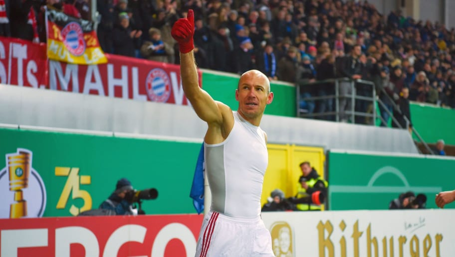 Bayern Munich's Dutch midfielder Arjen Robben celebrates at the end of the German football Cup DFB Pokal quarter-final match SC Paderborn versus Bayern Munich on February 6, 2018 in Paderborn.  Bayern Munich won 6-0. / AFP PHOTO / Patrik STOLLARZ / RESTRICTIONS: ACCORDING TO DFB RULES IMAGE SEQUENCES TO SIMULATE VIDEO IS NOT ALLOWED DURING MATCH TIME. MOBILE (MMS) USE IS NOT ALLOWED DURING AND FOR FURTHER TWO HOURS AFTER THE MATCH. == RESTRICTED TO EDITORIAL USE == FOR MORE INFORMATION CONTACT DFB DIRECTLY AT +49 69 67880   /         (Photo credit should read PATRIK STOLLARZ/AFP/Getty Images)