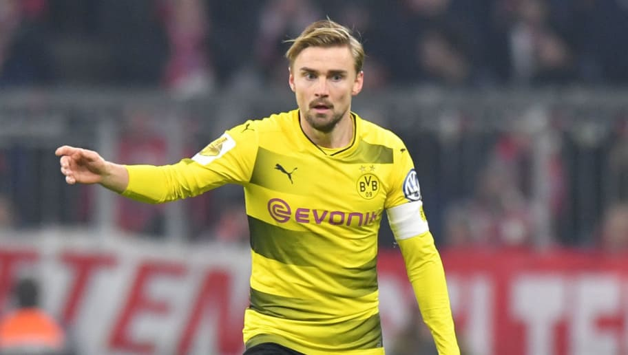 MUNICH, GERMANY - DECEMBER 20: Marcel Schmelzer of Dortmund plays the ball during the DFB Cup match between Bayern Muenchen and Borussia Dortmund at Allianz Arena on December 20, 2017 in Munich, Germany. (Photo by Sebastian Widmann/Bongarts/Getty Images)