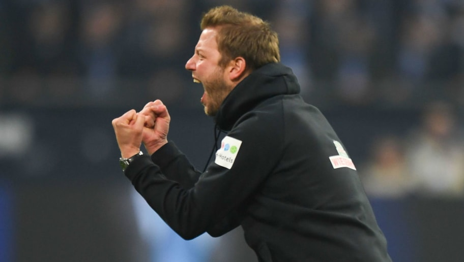 Bremen's German head coach Florian Kohfeldt reacts during the German first division Bundesliga football match Schalke 04 versus Werder Bremen on February 3, 2018 in Gelsenkirchen. / AFP PHOTO / Patrik STOLLARZ / RESTRICTIONS: DURING MATCH TIME: DFL RULES TO LIMIT THE ONLINE USAGE TO 15 PICTURES PER MATCH AND FORBID IMAGE SEQUENCES TO SIMULATE VIDEO. == RESTRICTED TO EDITORIAL USE == FOR FURTHER QUERIES PLEASE CONTACT DFL DIRECTLY AT + 49 69 650050         (Photo credit should read PATRIK STOLLARZ/AFP/Getty Images)
