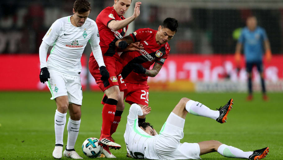 LEVERKUSEN, GERMANY - FEBRUARY 06:  (L-R) Max Kruse of Bremen, Dominik Kohr and Charles Aranguiz of Leverkusen and Thomas Delaney of Bremen fight for the ball during the DFB Cup quarter final match between Bayer Leverkusen and Werder Bermen at BayArena on February 6, 2018 in Leverkusen, Germany. (Photo by Christof Koepsel/Bongarts/Getty Images)