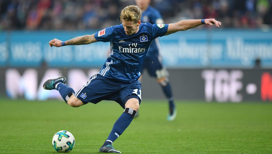 AUGSBURG, GERMANY - JANUARY 13: Andre Hahn of Hamburg takes a shot at the goal during the Bundesliga match between FC Augsburg and Hamburger SV at WWK-Arena on January 13, 2018 in Augsburg, Germany. (Photo by Sebastian Widmann/Bongarts/Getty Images)