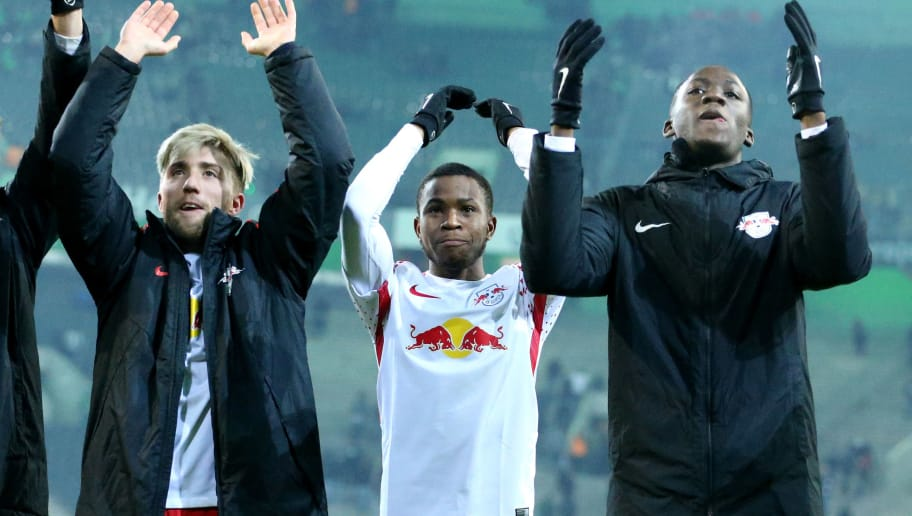 MOENCHENGLADBACH, GERMANY - FEBRUARY 03: (L-R) Kevin Kampl, Ademola Lookman and Jean-Kevin Augustin of Leipzig celebrate after winning 1-0 the Bundesliga match between Borussia Moenchengladbach and RB Leipzig at Borussia-Park on February 3, 2018 in Moenchengladbach, Germany. (Photo by Christof Koepsel/Bongarts/Getty Images)