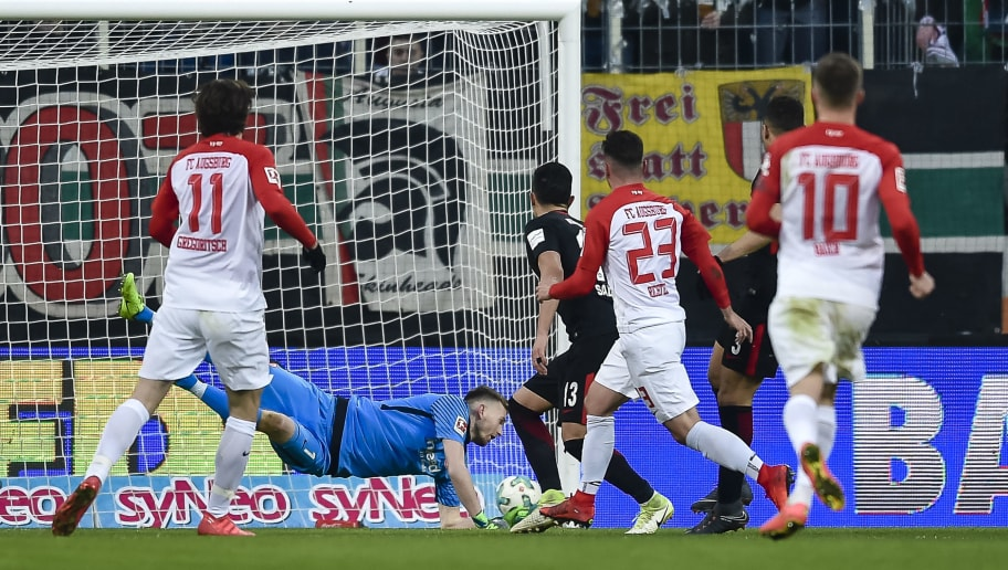 Augsburg's German forward Marco Richter scores the third goal during the German first division Bundesliga football match 1 FC Augsburg vs Eintracht Frankfurt in Augsburg, southern Germany, on February 4, 2018. / AFP PHOTO / Guenter SCHIFFMANN / RESTRICTIONS: DURING MATCH TIME: DFL RULES TO LIMIT THE ONLINE USAGE TO 15 PICTURES PER MATCH AND FORBID IMAGE SEQUENCES TO SIMULATE VIDEO. == RESTRICTED TO EDITORIAL USE == FOR FURTHER QUERIES PLEASE CONTACT DFL DIRECTLY AT + 49 69 650050         (Photo credit should read GUENTER SCHIFFMANN/AFP/Getty Images)