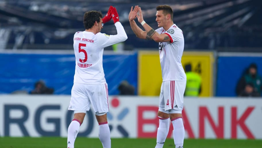 Bayern Munich's Mats Hummels and teammate Niklas Suele celebrate after a goal during the German football Cup DFB Pokal quarter-final match SC Paderborn versus Bayern Munich on February 6, 2018 in Paderborn.  / AFP PHOTO / Patrik STOLLARZ / RESTRICTIONS: ACCORDING TO DFB RULES IMAGE SEQUENCES TO SIMULATE VIDEO IS NOT ALLOWED DURING MATCH TIME. MOBILE (MMS) USE IS NOT ALLOWED DURING AND FOR FURTHER TWO HOURS AFTER THE MATCH. == RESTRICTED TO EDITORIAL USE == FOR MORE INFORMATION CONTACT DFB DIRECTLY AT +49 69 67880   /         (Photo credit should read PATRIK STOLLARZ/AFP/Getty Images)