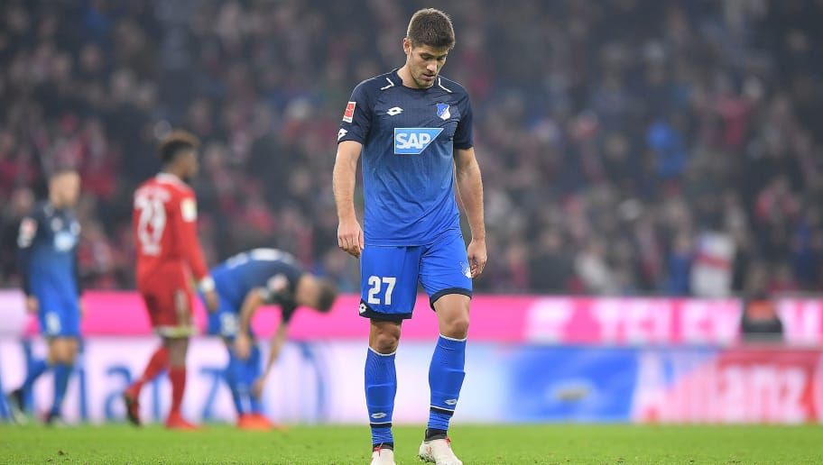MUNICH, GERMANY - JANUARY 27: Andrej Kramaric of Hoffenheim walks off the pitch dejected after the Bundesliga match between FC Bayern Muenchen and TSG 1899 Hoffenheim at Allianz Arena on January 27, 2018 in Munich, Germany. (Photo by Sebastian Widmann/Bongarts/Getty Images)