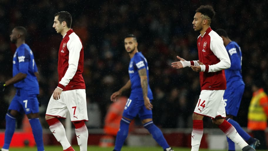 Arsenal's Nigerian striker Alex Iwobi (2L), Arsenal's Armenian midfielder Henrikh Mkhitaryan (C) and Arsenal's Gabonese striker Pierre-Emerick Aubameyang walk onto the pitch at the English Premier League football match between Arsenal and Everton at the Emirates Stadium in London on February 3, 2018.  / AFP PHOTO / Adrian DENNIS / RESTRICTED TO EDITORIAL USE. No use with unauthorized audio, video, data, fixture lists, club/league logos or 'live' services. Online in-match use limited to 75 images, no video emulation. No use in betting, games or single club/league/player publications.  /         (Photo credit should read ADRIAN DENNIS/AFP/Getty Images)