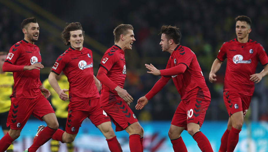 DORTMUND, GERMANY - JANUARY 27: Nils Petersen of Freiburg (3rd right) celebrates with his team after he scored a long distance goal to make it 1:2 during the Bundesliga match between Borussia Dortmund and Sport-Club Freiburg at Signal Iduna Park on January 27, 2018 in Dortmund, Germany. (Photo by Lars Baron/Bongarts/Getty Images)