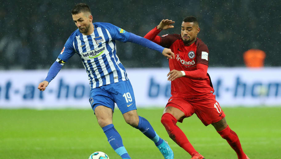 BERLIN, GERMANY - DECEMBER 03:  Vedad Ibisevic (L) of Berlin battles for the ball with Kevin Prince Boateng of Frankfurt during the Bundesliga match between Hertha BSC and Eintracht Frankfurt at Olympiastadion on December 3, 2017 in Berlin, Germany. (Photo by Matthias Kern/Bongarts/Getty Images)