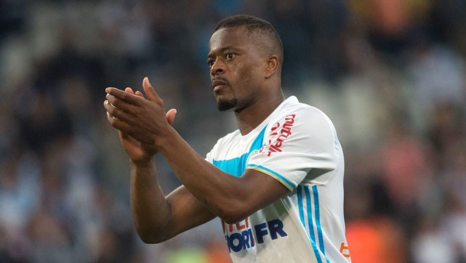 Olympique de Marseille French defender Patrice Evra acknowledges the crowd following the French L1 football match between Marseille (OM) and Bastia (SCB) on May 20, 2017, at the Velodrome stadium in Marseille, southern France / AFP PHOTO / BERTRAND LANGLOIS        (Photo credit should read BERTRAND LANGLOIS/AFP/Getty Images)