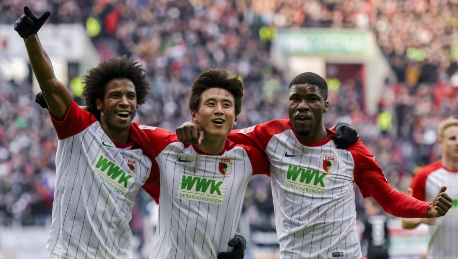 Augsburg's Brazilian midfielder Caiuby, Augsburg's Korean midfielder Koo Ja-Cheol and Augsburg's Austrian defender Kevin Danso celebrate the first goal for their team during the German first division Bundesliga football match 1 FC Augsburg vs Eintracht Frankfurt in Augsburg, southern Germany, on February 4, 2018. / AFP PHOTO / Guenter SCHIFFMANN / RESTRICTIONS: DURING MATCH TIME: DFL RULES TO LIMIT THE ONLINE USAGE TO 15 PICTURES PER MATCH AND FORBID IMAGE SEQUENCES TO SIMULATE VIDEO. == RESTRICTED TO EDITORIAL USE == FOR FURTHER QUERIES PLEASE CONTACT DFL DIRECTLY AT + 49 69 650050         (Photo credit should read GUENTER SCHIFFMANN/AFP/Getty Images)