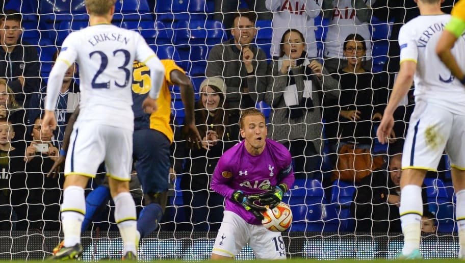 The ball slips through the fingers of Tottenham Hotspur's fill-in goalkeeper English striker Harry Kane (C), who covered goalkeeping duties after Tottenham Hotspur's French goalkeeper Hugo Lloris was sent off, from a free kick from Asteras Tripolis's Argentinian forward Jeronimo Barrales for Asteras Tripoli's only goal during the UEFA Europa League group C football match between Tottenham Hotspur and Asteras Tripolis at White Hart Lane in north London, on October 23, 2014. AFP PHOTO / GLYN KIRK        (Photo credit should read GLYN KIRK/AFP/Getty Images)