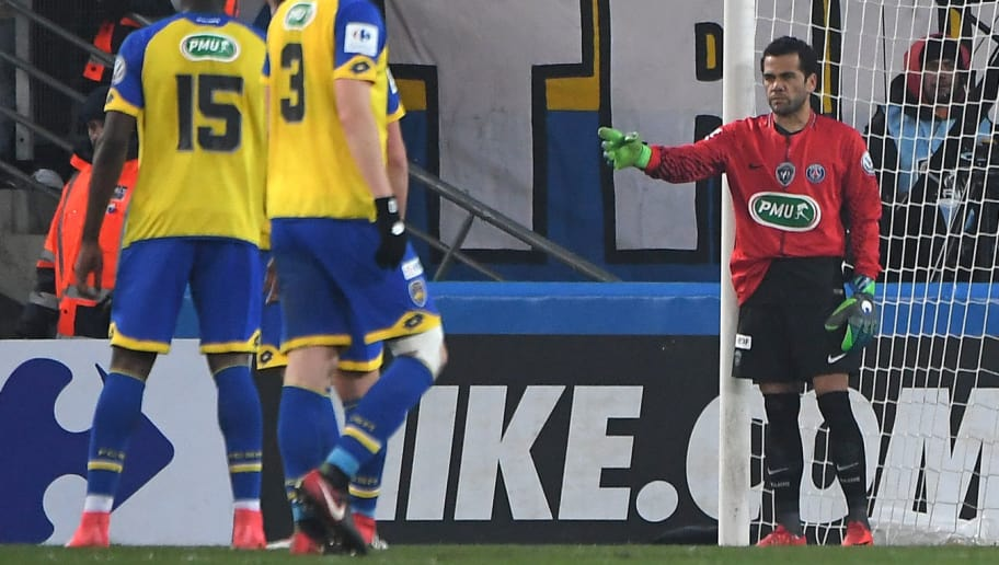 Paris Saint-Germain's Brazilian defender Daniel Alves (R) plays as goalkeeper after Paris Saint-Germain's German goalkeeper Kevin Trapp received a red card during the French Cup football match between Sochaux (FCSM) and Paris Saint-Germain (PSG) on February 6, 2018 at the Auguste Bonal Stadium in Montbeliard, eastern France.  / AFP PHOTO / PATRICK HERTZOG        (Photo credit should read PATRICK HERTZOG/AFP/Getty Images)