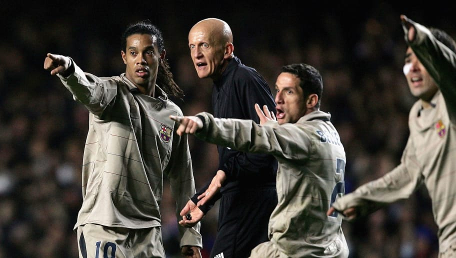 LONDON - MARCH 8:  Barcelona players complain at Pierluigi Collina, the referee, during the UEFA Champions League, First Knockout Round, Second Leg match between Chelsea and Barcelona at Stamford Bridge on March 8, 2005 in London, England.  (Photo by Shaun Botterill/Getty Images)