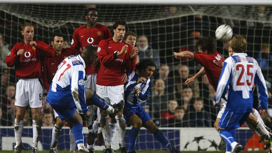 MANCHESTER, ENGLAND - MARCH 9:  Benni McCarthy of FC Porto takes a free kick which leads to a goal from teammate Costinha during the UEFA Champions League match between Manchester United and FC Porto at Old Trafford on March 9, 2004 in Manchester, England.  (Photo by Laurence Griffiths/Getty Images)