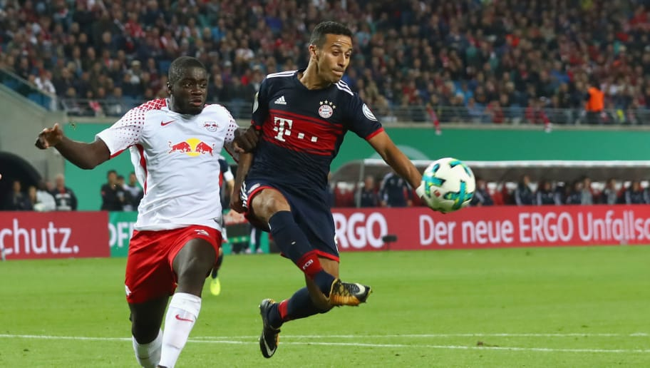 LEIPZIG, GERMANY - OCTOBER 25:  Thiago Alcantara (R) of Bayern Muenchen battles for the ball with Dayot Upamecano of Leipzig during the DFB Cup round 2 match between RB Leipzig and Bayern Muenchen at Red Bull Arena on October 25, 2017 in Leipzig, Germany.  (Photo by Alexander Hassenstein/Bongarts/Getty Images)