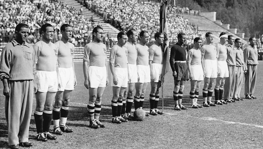Italian national soccer team players pose for a group picture, 10 June 1934 in Rome, before their World Cup final against Czechoslovakia.  Italy won the title beating Czechoslovakia 2-1 in extra time. (From 2nd L : Luis Monti, and from 4th L : Angelo Schiavio, Raimundo Orsi, Giovanni Ferrari, Enrique Guaita, Giuseppe Meazza - with flag -, Giamperro Combi, Attilio Ferraris IV, Luigi Allemandi, Luigi Bertolini) (Photo credit should read STAFF/AFP/Getty Images)