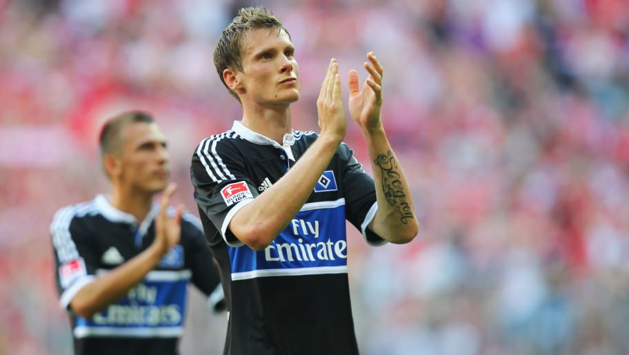 MUNICH, GERMANY - AUGUST 20:  Marcell Jansen (R) of Hamburg reacts during the Bundesliga match between FC Bayern Muenchen and Hamburger SV at Allianz Arena on August 20, 2011 in Munich, Germany.  (Photo by Martin Rose/Bongarts/Getty Images)