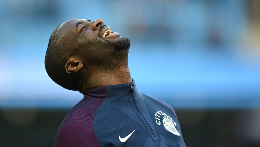 Manchester City's Ivorian midfielder Yaya Toure warms up during the English FA Cup third round football match between Manchester City and Burnley at Etihad Stadium in Manchester, north west England on January 6, 2018. / AFP PHOTO / Oli SCARFF / RESTRICTED TO EDITORIAL USE. No use with unauthorized audio, video, data, fixture lists, club/league logos or 'live' services. Online in-match use limited to 75 images, no video emulation. No use in betting, games or single club/league/player publications.  /         (Photo credit should read OLI SCARFF/AFP/Getty Images)