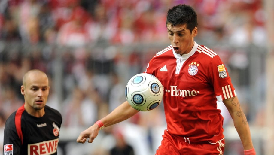 RESTRICTIONS / EMBARGO - ONLINE CLIENTS MAY USE UP TO SIX IMAGES DURING EACH MATCH WITHOUT THE AUTHORISATION OF THE DFL. NO MOBILE USE DURING THE MATCH AND FOR A FURTHER TWO HOURS AFTERWARDS IS PERMITTED WITHOUT THE AUTHORISATION OF THE DFL. Bayern Munich's Argentinian midfielder Jose Ernesto Sosa (R) vies with Cologne's Slovenian defender Miso Brecko during the German first division Bundesliga football match FC Bayern Munich vs 1.FC Cologne in the southern German city of Munich on October 3, 2009. AFP PHOTO DDP / OLIVER LANG GERMANY OUT (Photo credit should read OLIVER LANG/AFP/Getty Images)